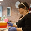 Globe/Roger Nomer<br /> Kristen Radaker Sheafer works at the Frosted Cakerie in Joplin on Thursday. She favors changes to downtown parking because it would make downtown more walkable.