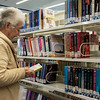 Globe/Roger Nomer<br /> Pat McMillan, Joplin, looks through the large print section of the Joplin Public Library on Wednesday.