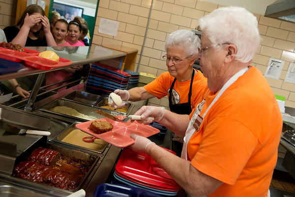 Globe/Roger Nomer<br /> Anita Hill, left, and Mary Garringer serve lunch on Wednesday at Mt. Vernon Middle School.