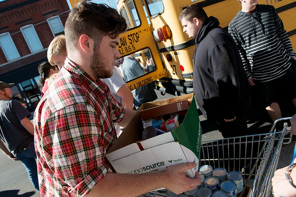 Globe/Roger Nomer<br /> Matthew Horner, Joplin High School senior, helps unload food donations from Franklin Tech at Souls Harbor on Thursday afternoon.