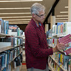 Globe/Roger Nomer<br /> Mark Frerer, Loma Linda, browses books on Wednesday at the Joplin Public Library.
