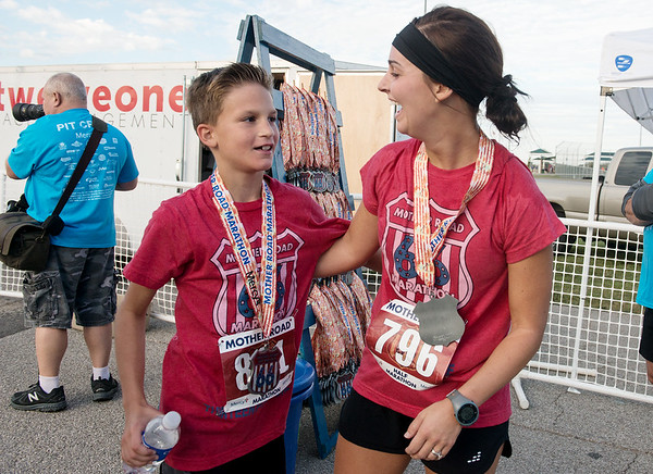 Globe/Roger Nomer<br /> Anna Busby, Webb City, reacts to hearing her nephew Jace Schulte's, 11, time in the Mother Road Half Marathon on Sunday in Joplin. Schulte came in 8th overall with a time of one hour, 41 minutes.