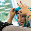 Globe/Roger Nomer<br /> Michaela Williams, a Missouri Southern sophomore from Springfield, helps Akari Taoka, an international student from Japan, with a hijab during the Muslim Student Union's Hijab Day on Thursday at MSSU.