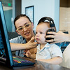 Globe/Roger Nomer<br /> Emily and Crusoe Hein, 15 months, use a computer on Wednesday at the Joplin Public Library.