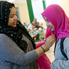 Globe/Roger Nomer<br /> Michaela Williams, a Missouri Southern sophomore from Springfield, helps Soyoung Lee, an international student from South Korea, with a hijab during the Muslim Student Union's Hijab Day on Thursday at MSSU.