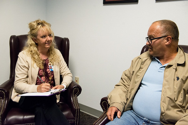 Globe/Roger Nomer<br /> Kathi Murphy, a licensed clinical social worker with Ozark Center, talks with Randy Hanke on Wednesday at the Ozark Center Community Care Program.
