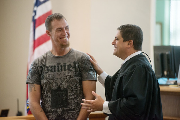 Globe/Roger Nomer<br /> Judge John Nicholas talks with Justin Cozart during Monday's graduation ceremony in Veterans Court at the Jasper County Courthouse.