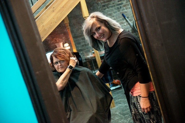 Globe/Roger Nomer<br /> Juanita Taylor, Carl Junction, checks out her purple hair extension with stylist Catlyn Pink on Tuesday at Salon 529.