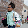 Globe/Roger Nomer<br /> Hannah Brown, Pittsburg Middle school sixth grader, carries backpacks into the Kansas Department for Children and Families on Friday.