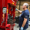 Globe/Roger Nomer<br /> Randy Stark operates a press at ZAF Energy Systems on Monday.