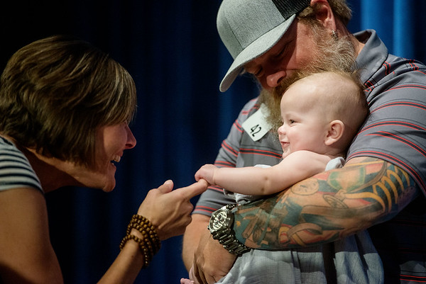 Globe/Roger Nomer<br /> Kutter Brown, 3 months, charms pageant judge Jessica Alberty as he is held by dad Toby, Carthage, during the annual Maple Leaf Baby Pageant on Saturday at the Carthage R-9 Auditorium.