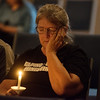 Globe/Roger Nomer<br /> Rose Mary Ferguson, Carl Junction prays for victims of the Las Vegas shootings on Monday at Fir Road Christian Church in Carl Junction.