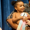 Globe/Roger Nomer<br /> Valentina Vazquez-DeSaunders, 1, Carthage, clutches her first-place ribbon during Saturday's Maple Leaf Baby Pageant.