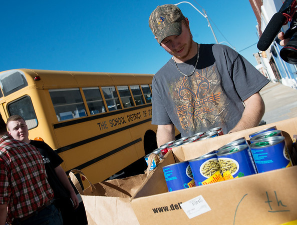 Globe/Roger Nomer<br /> Kohl Wallace, Joplin High senior, helps unload food donations from Franklin Tech at Souls Harbor on Thursday afternoon.