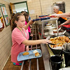Globe/Roger Nomer<br /> Kyra Stockton, sixth grade, gets lunch on Wednesday at Mt. Vernon Middle School.