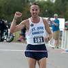 Globe/Roger Nomer<br /> Scott Cichon, Pittsburg, pumps his fist as he wins the Mother Road Marathon on Sunday in Joplin.