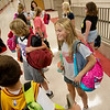 Globe/Roger Nomer<br /> Abi Beaman, Pittsburg Middle School sixth grader, prepares to load backpacks on Friday.
