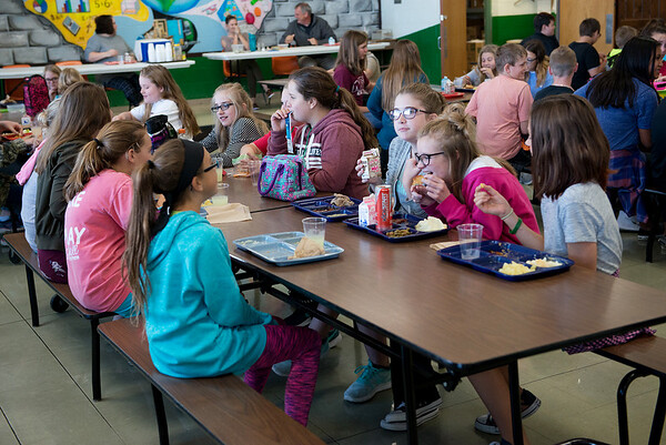 Globe/Roger Nomer<br /> Sixth graders eat lunch on Wednesday at Mt. Vernon Middle School.