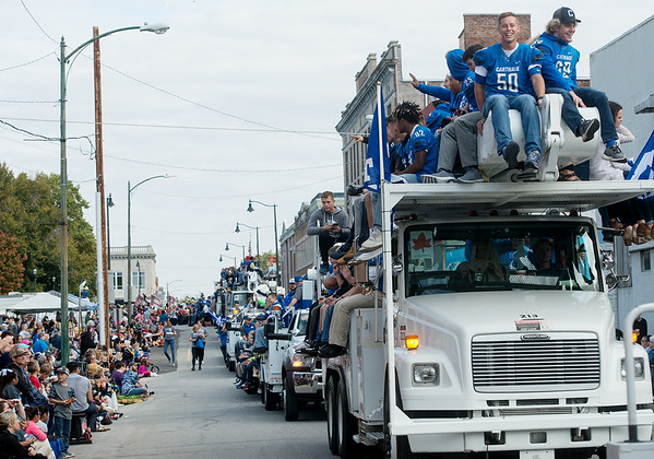 Globe/Roger Nomer<br /> Members of the Carthage High football team ride utility trucks in Saturday's Maple Leaf Parade in Carthage.