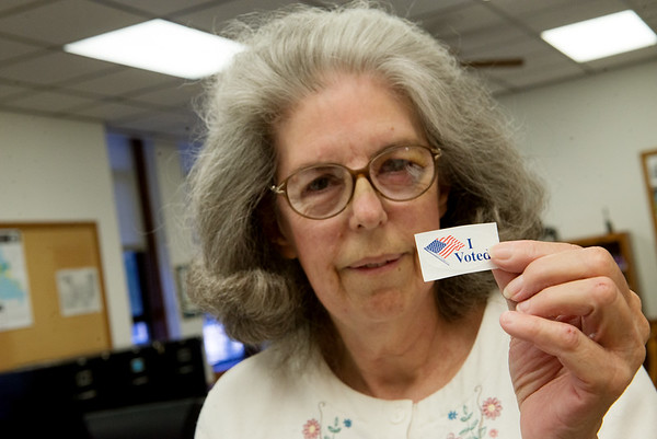 Linda Goodman displays a voting sticker during an interview on Monday at the Newton County Courthouse.<br /> Globe   Roger Nomer