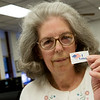 Linda Goodman displays a voting sticker during an interview on Monday at the Newton County Courthouse.<br /> Globe | Roger Nomer