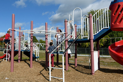 Students from Ashley Wolf's second grade class at Granby Elementary enjoy recess on Friday afternoon at the school. The district is reviewing the success of their four-day school week after two years of implementation. Globe | Laurie Sisk