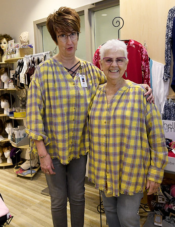From the left: Lisa Nelson, certified fitter at Sisters Boutique, poses with cancer patient Stella McGowen in their matching flannel blouses at the boutique inside Joplin Mercy.<br /> Globe | Laurie Sisk