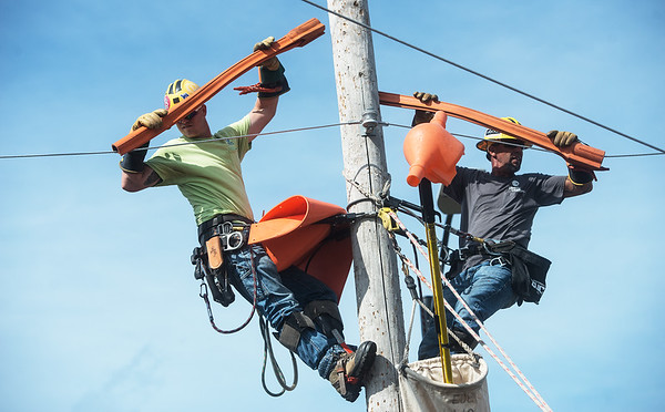 Landon Ryser, left, and Robert Vaness train in preparation for the Internation Lineman's Rodeo at Liberty Utilities Empire District on Monday.<br /> Globe | Roger Nomer