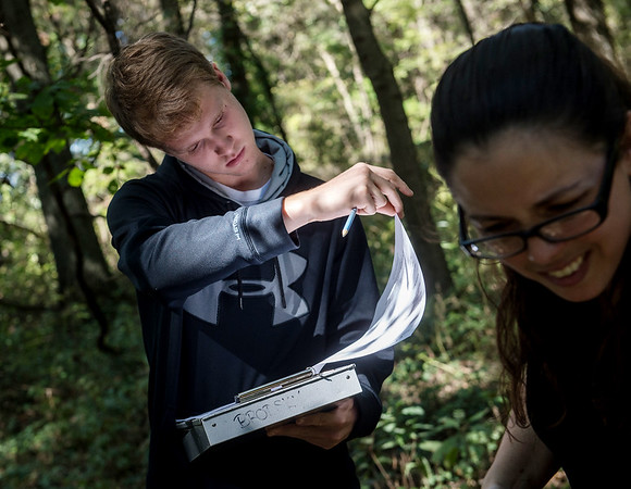 Caleb Durbin, a Pittsburg State University junior from Chanute, and Christine Brodsky, assistant professor of biology at PSU, report information about a wildlife camera location on Friday near Pittsburg.<br /> Globe | Roger Nomer