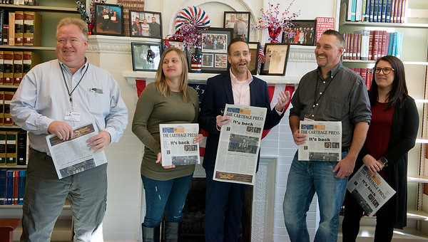 (from left) John Hacker, Skyla and Matthew Rush, and David and Sarah Hoover announce the launch of the new Carthage Press during a press conference on Thursday at the Carthage Public Library.<br /> Globe | Roger Nomer