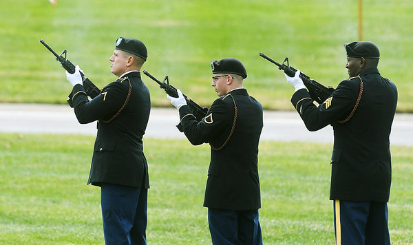 Soldiers from the 101st Brigade Support Battalion, 1st Armored Brigade Combat Team from Fort Riley, fire a rifle salute for WWII soldier Leslie Shankles, of Arcadia, during his burial with full military honors at the Fort Scott National Cemetery on Wednesday.<br /> Globe   Laurie SIsk