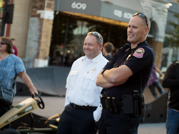 Joplin Fire Chief James Furgerson and Police Chief Matt Stewart watch a race during Third Thursday in downtown Joplin. The fire and police chiefs were on hand to promote the passage of Prop B.<br /> Globe | Roger Nomer