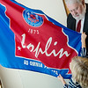 Joplin Mayor Gary Shaw shows Taylor Duncan, 5, the Joplin flag on Thursday at City Hall.<br /> Globe | Roger Nomer