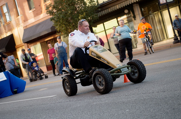 Joplin Fire Chief Furgerson rides in a race during Third Thursday in downtown Joplin. The fire and police chiefs were on hand to promote the passage of Prop B.<br /> Globe | Roger Nomer