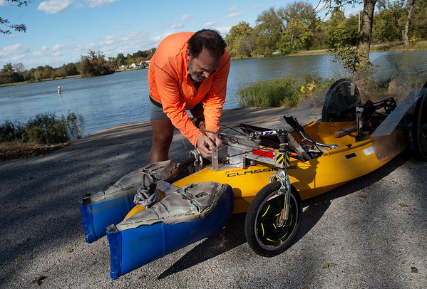 Randy Ridings prepares his quadyak for the water on Monday at Kellogg Lake.<br /> Globe | Roger Nomer