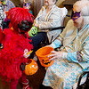 Everleigh Burpo, pre-kindergarten student at St. Mary's Elementary, gets a Halloween treat from Billie Ginn while visiting the Communities of Wildwood on Thursday. St. Mary's students traveled on a hayride escorted by a firetruck to the home.<br /> Globe | Roger Nomer