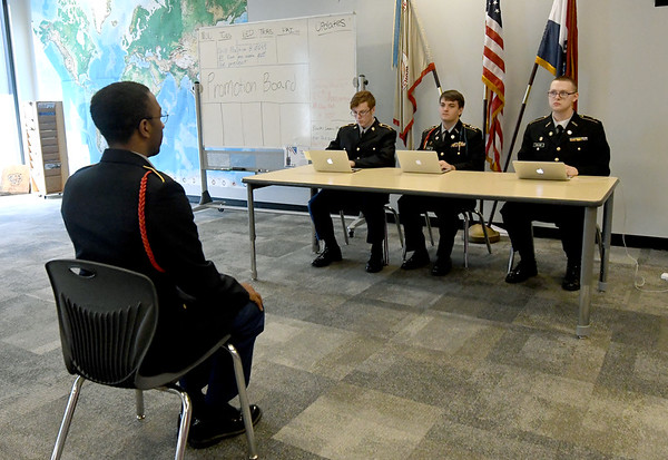 From the left: Joplin High School JROTC Cadet Ja Kai Bryant answers questions before the promotion board of fellow cadets David Ward, John Pogue and Gavin Malone on Thursday at JHS. The JHS JROTC will be celebrating its 100th Anniversary this spring.<br /> Globe | Laurie Sisk