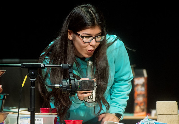Vanessa Tapia, Pittsburg State University senior, uses an empty bottle to produce a wind effect on Tuesday at the Bicknell Family Center for the Arts.<br /> Globe | Roger Nomer