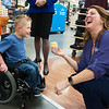 Heather Lesmeister, program director for Children's Miracle Network, laughs as Zane Smythia, 5, dips his nose in a cupcake on Wednesday at the 15th Street Walmart. On Tuesday, Children's Miracle Network celebrated a large donation from local Walmart and Sam's Club associates raised by in-store fundraising activities.<br /> Globe | Roger Nomer