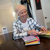 Rachele' Davis reflects on cards sent to her by friends during her treatment for breast cancer on Oct. 16.<br /> Globe | Roger Nomer