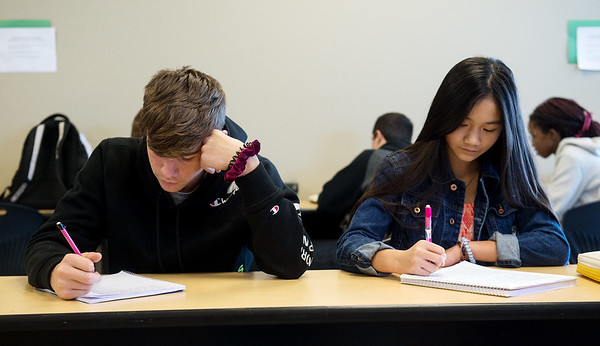 Luke Galbreath and Angela Nguyen, eighth graders at East Middle School, work on an assignment in a comm arts class on Thursday.<br /> Globe | Roger Nomer