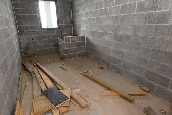 Construction continues on one of eight detention cells at the new Jasper County Juvenile Justice Center on Wednesday at the center near Sixth and Pearl streets.<br /> Globe | Laurie Sisk