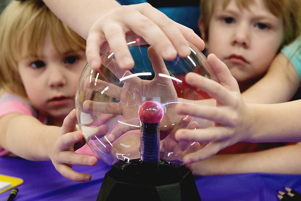 Children play with a plasma globe during the Creative Learning Alliance's community forum on a children's museum on Tuesday at the Joplin Public Library.<br /> Globe | Roger Nomer