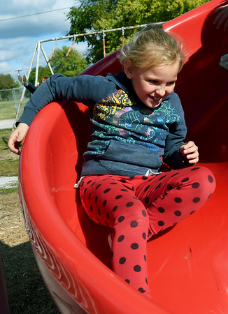Granby second grader Bailey Caldwell, 7, enjoys a trip down a slide during recess on Friday at Granby Elementary. The district is reviewing the success of their four-day school week after two years of implementation.<br /> Globe | Laurie Sisk