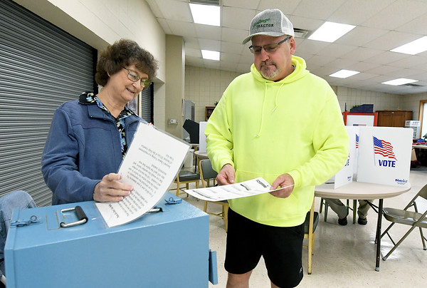 From the left: Election official Sue Becker assists Steve Southern as he casts his ballot during early voting for the 2018 midterm election at the Homer Cole Community Center on Tuesday in Pittsburg. Election officials reported heavy turnout for early voting at the site.<br /> Gobe | Laurie SIsk