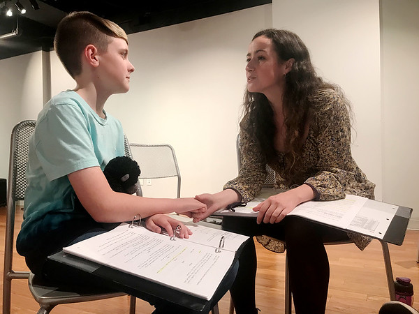 Camryn Burniston and Madelyn Monaghan rehearse a scene as Cayden and Lenna, (respectively), a boy affected by lead poisoning and his mother, unsure of how to provide for him. (Quentin Madia)