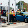 Firefighters work to extract the driver of a vehicle following an accident at Sixth and Joplin on Thursday afternoon.<br /> Globe | Roger Nomer