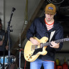 """Members of the band """"Trey"""" entertain visitors from inside a garage during Porch Fest on Saturday in the North Heights Neighborhood.<br /> Globe 