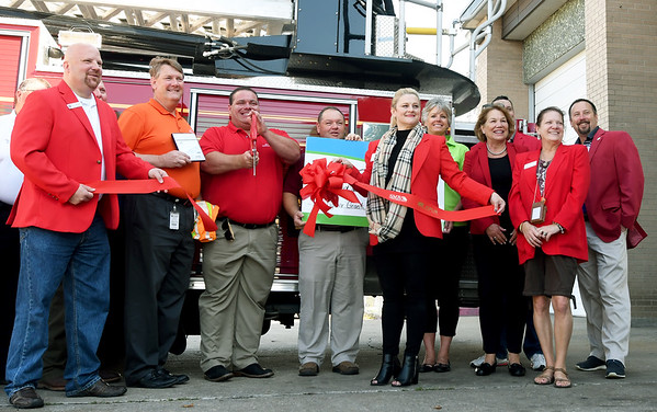 Representatives from Missouri American Water, the Joplin Fire Department and the Joplin Area Chamber of Commerce gather Friday morning at the JFD for the presentation of a check for $1,200 to the JFD for the purchase of high visibillity vests. The grant continues an annual grant from Missouri American Water to the JFD.<br /> Globe | Laurie Sisk