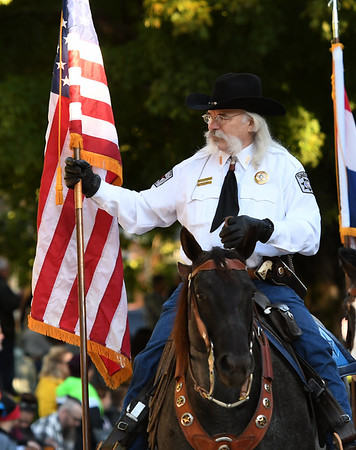Col. Ron Millard, of the Jasper County Sheriffs Posse, helps lead off the Maple Leaf Parade as it makes its way down Grand Avenue on Saturday in Carthage.<br /> Globe | Laurie Sisk